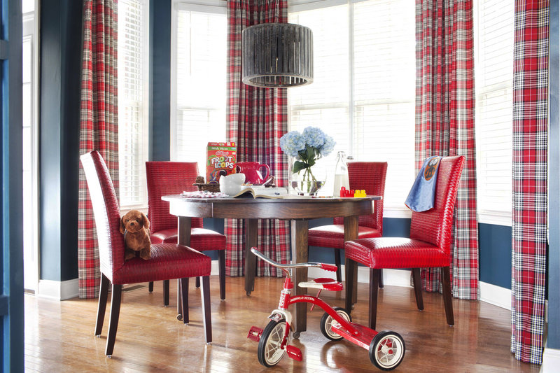 A breakfast nook showcases classic patterns such as plaid, youthful primary colors, and even commercial-grade automotive vinyl that serves as kid-friendly upholstery.