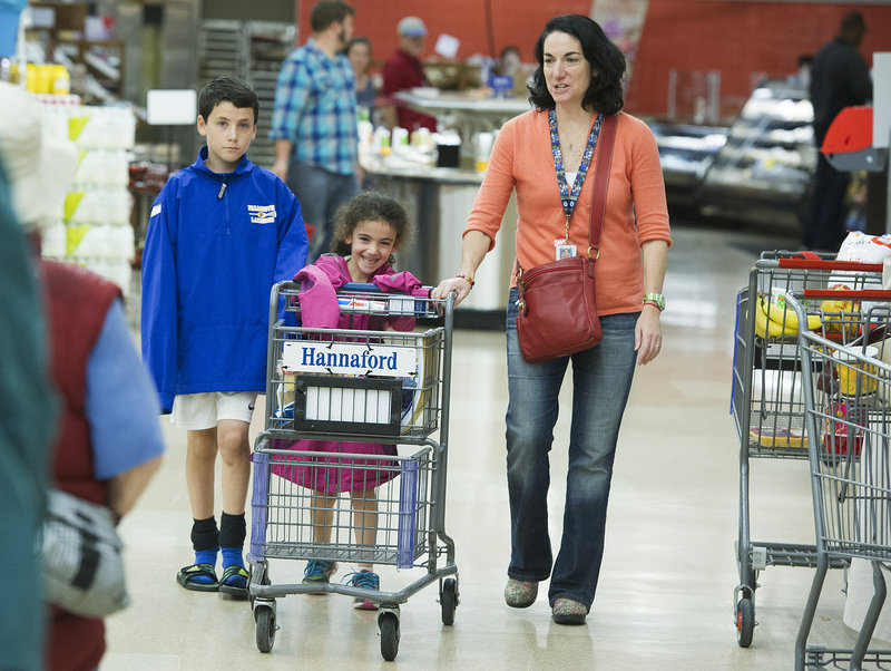 "Julie Greene, manager for healthy living at Hannaford, shops with her children, Ben, 10, and Anna, 6. ""If you involve (your children) in the decisions about what they want to eat,"" Greene said, ""they're much more likely to eat it."""
