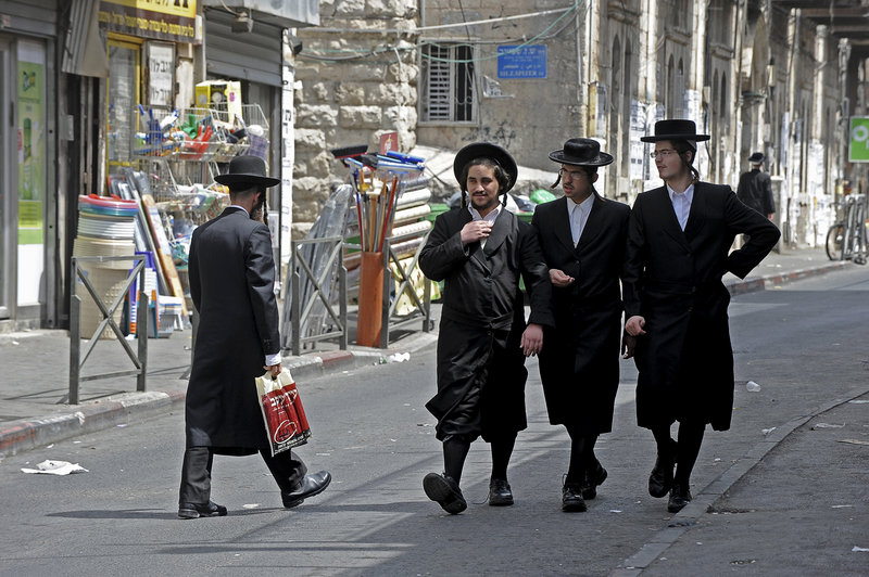 Ultra-Orthodox Jews known as Haredi may soon join their secular counterparts in taking responsibility to defend Israel Shown above are Haredi Jews in the Me'a She'arim neighborhood in Jerusalem and, below, Haredi Jews during religious studies in the Sha'arei Hesed neighborhood in Jerusalem.