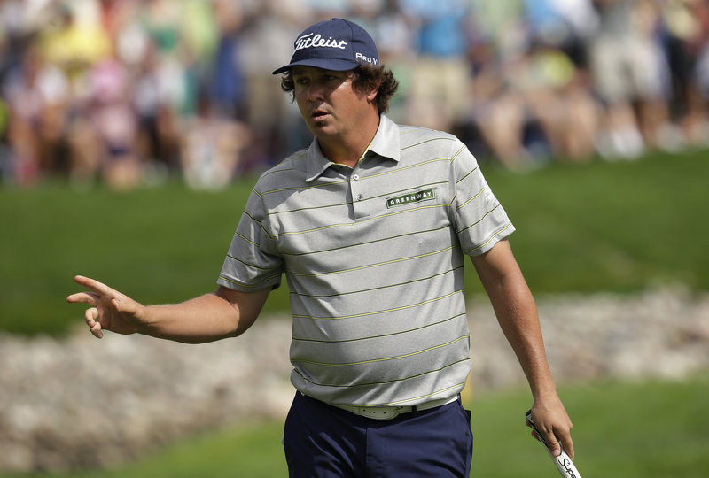 Jason Dufner, stoic as ever, shows little emotion after sinking a birdie putt on the 11th hole during the second round of the PGA Championship at Oak Hill Country Club in Pittsford, N.Y.