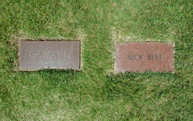 The headstone marking the grave of Lee Harvey Oswald lies next to a marker inscribed with the name Nick Beef, at Shannon Rose Hill Cemetery in Fort Worth, Texas.