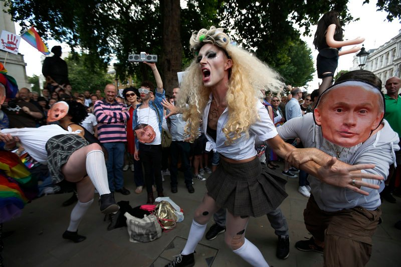 Gay activists stage a play in London where gay people are restrained by others wearing masks depicting Russian President Vladimir Putin during a protest Saturday.