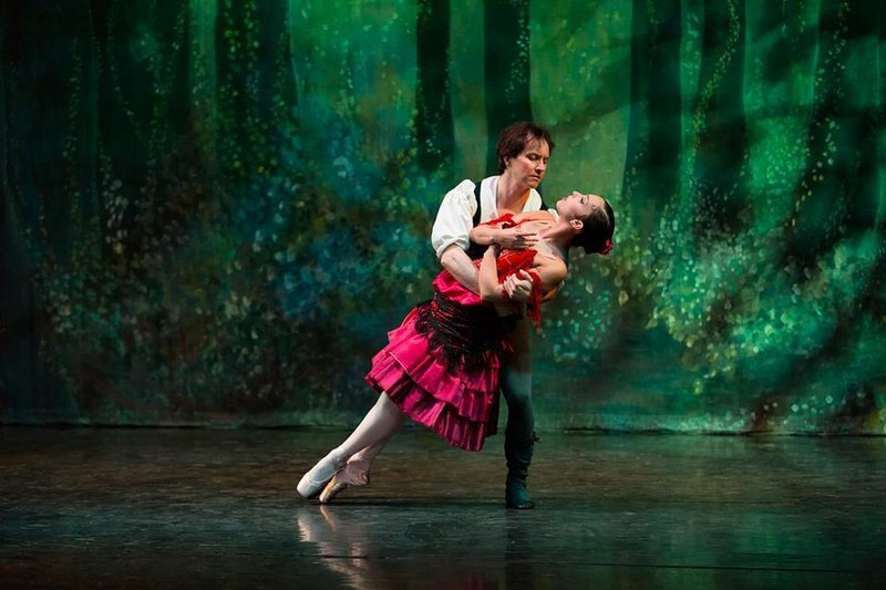 """Glenn Davis and Caitlin Bernard dance as Basilio and Kitri in the Maine State Ballet production of """"Don Quixote,"""" which continues this week."""