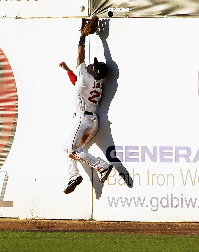 Matty Johnson turns in one of the best catches of the season for the Sea Dogs, leaping against the right-field fence in the third inning of a 9-6 loss to the Bowie Baysox at Hadlock.