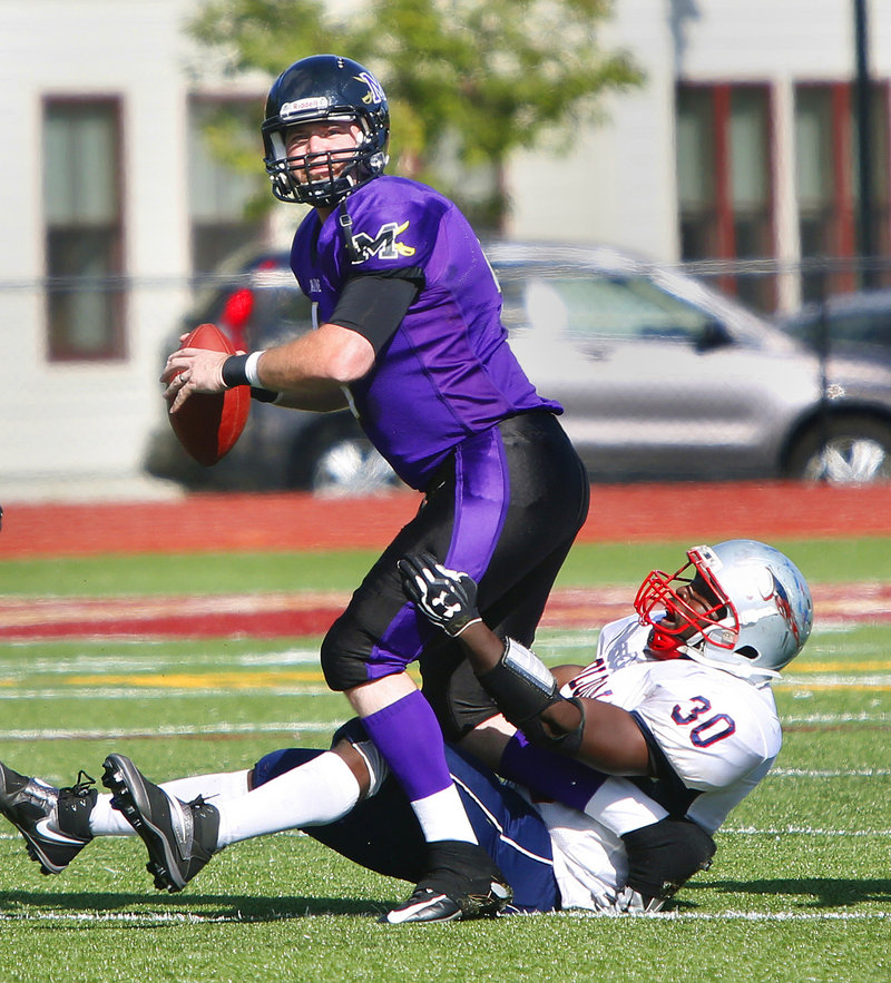 Jeremy Shorey, attempting to avoid Tyrelle Robinson of Metrowest, completed 15 of 22 passes for 224 yards and two touchdowns.