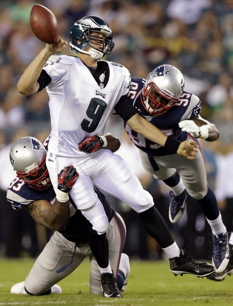 Tommy Kelly, left, combines with Chandler Jones to sack Eagles QB Nick Foles in Friday's preseason game at Philadelphia. Kelly, who played nine years with the Raiders, is off to a good start in New England.