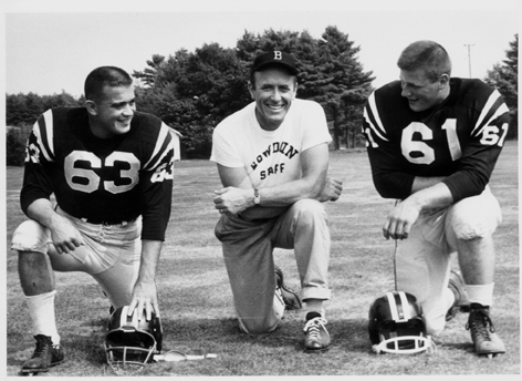 C. Nels Corey loved nothing better than to be with his football players while coaching at Bowdoin College. In 1962 that included Charlie Speleotis, left, and Dave Fernald.