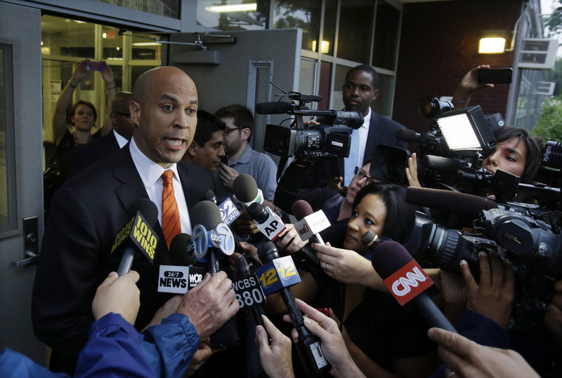 Newark Mayor Cory Booker answers a question after voting Tuesday in Newark, N.J. He won the Democratic primary.