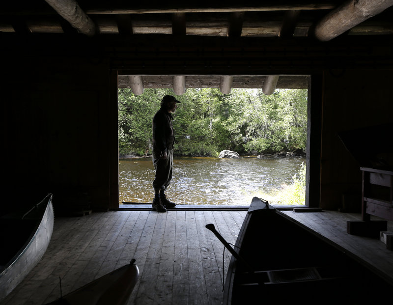 Frenette in the camp's boathouse. Frenette has done much of the restoration work.