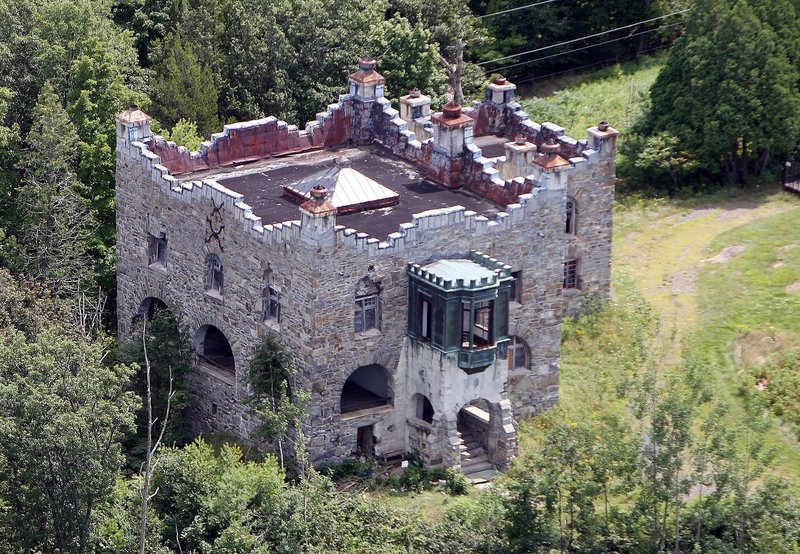 In this photo taken Wednesday Aug. 7, 2013 Kimball Castle is seen in Gilford, N.H. It was built in the late 1890s for Benjamin Ames Kimball, who was president of the Boston-Montreal Railroad. The decrepit castle with commanding views of the Lake Winnipesaukee is under the threat of a wrecking ball in its near future. (AP Photo/Jim Cole)