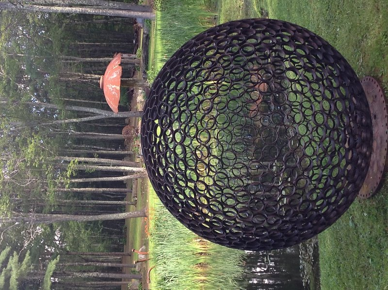 "Jay Sawyer has dotted his property in Warren with the sculptures that he creates from salvaged materials, including ""Samosphere IV: A Space for The Spirit."