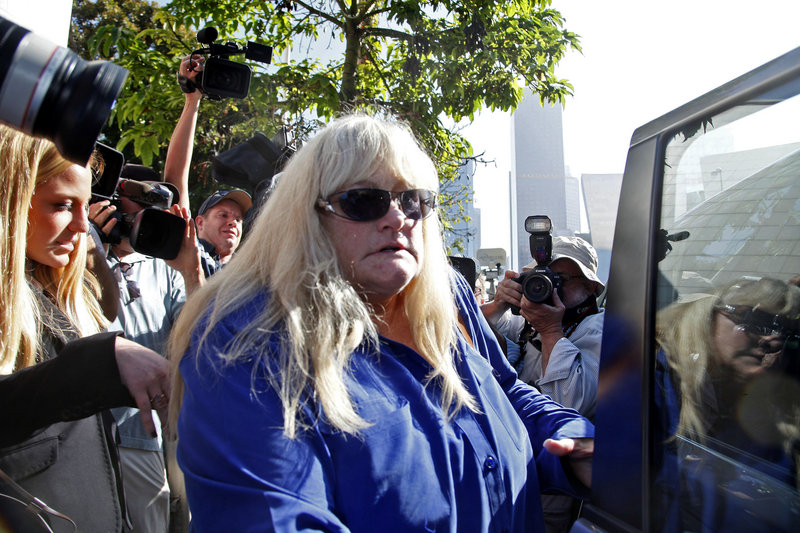 Debbie Rowe, Michael Jackson's former wife and the mother of two of his children, leaves court in Los Angeles on Wednesday.