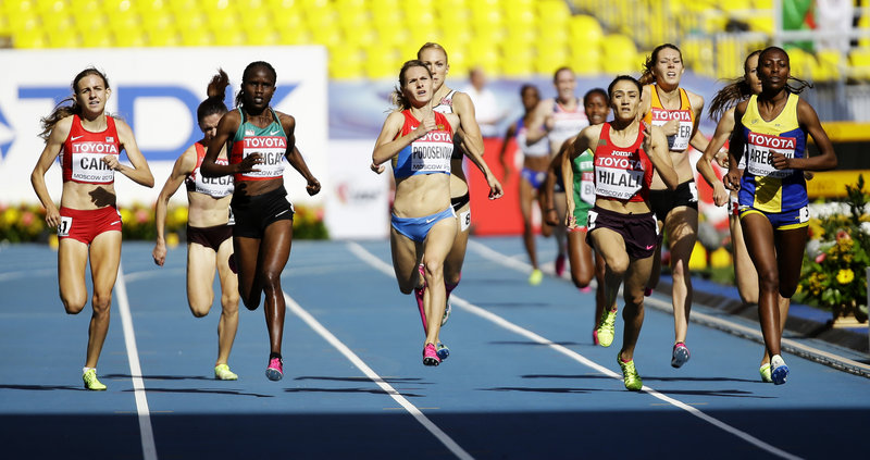 Mary Cain, far left, matches Kenya's Nancy Jebet Langat, Russia's Svetlana Podosenova, Morocco's Siham Hilali and Sweden's Abeba Aregawi in a 1,500-meter heat at the world athletics championship in Moscow.