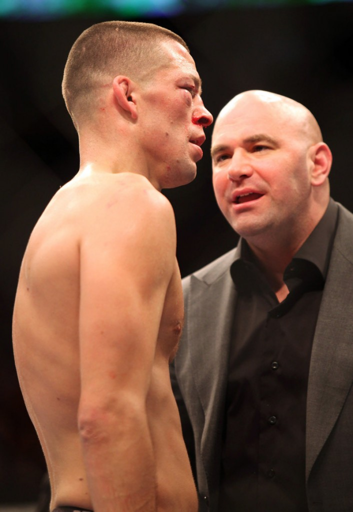 Dana White, right, has overseen the rise of professional mixed martial arts from his upbringing in Maine to his role as UFC president.