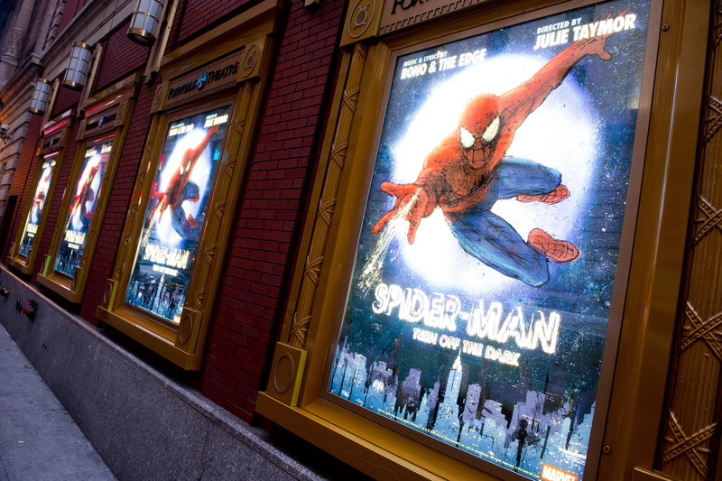 "Posters for the Broadway musical ""Spider-Man: Turn Off the Dark"" hang outside the Foxwoods Theatre in New York."