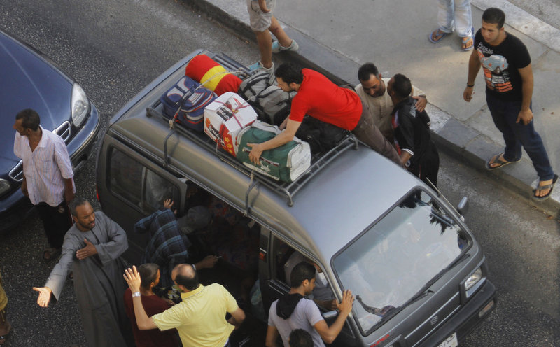 Egyptian volunteers search for militants at a makeshift checkpoint on Cornich El-Nile street in Cairo.