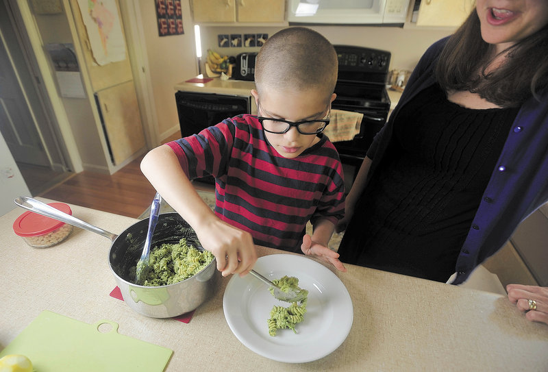 Noah Koch, 9, of Waterville, prepares his award winning pesto at his Waterville home on Friday. Noah was selected as a winner in First Lady Michelle Obama's Healthy Lunchtime Challenge, an honor that brought the local boy to Washington to meet the First Lady and President Obama.