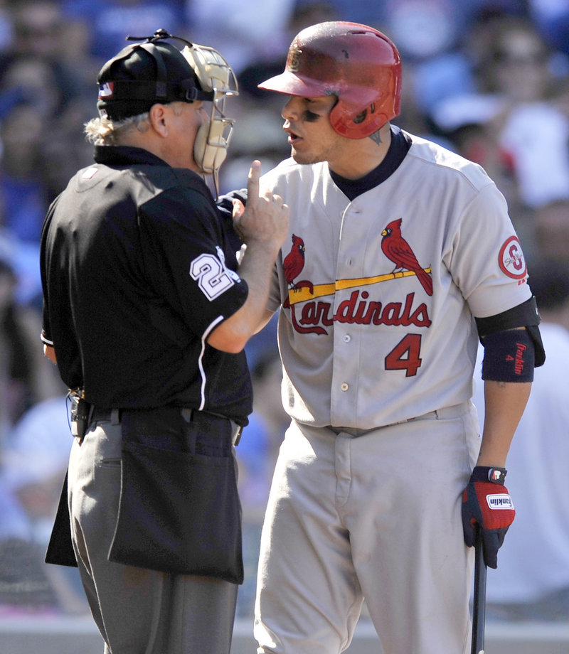 Yadier Molina of the St. Louis Cardinals argues with umpire Tom Hilton after striking out during a 4-0 win over the Cubs at Chicago on Saturday.