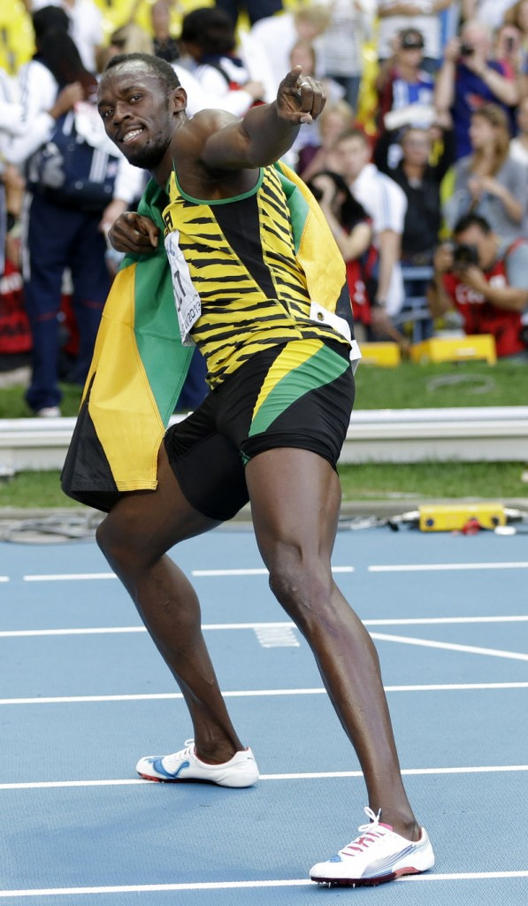 Usain Bolt of Jamaica strikes his classic pose after winning the 200 meters at the world track and field championships in Moscow on Saturday.
