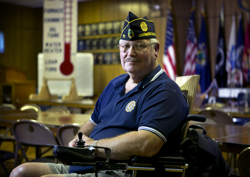Don Simoneau, executive director of American Legion Post 10 in Livermore Falls, sits in his wheelchair in the hall that once drew large numbers of bingo players.