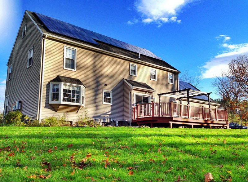 Ben Kunz' house with solar panels installed on the roof in Cheshire, Conn.