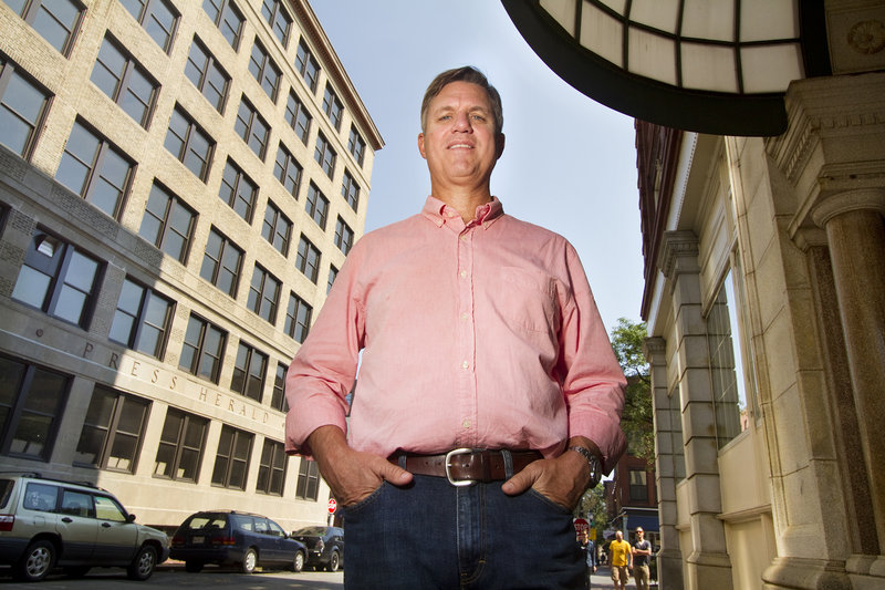 Hotel developer Jim Brady stands outside the former Portland Press Herald building, left, at Congress and Exchange streets last week. Brady is converting the site into a 110-room hotel, with plans to open in spring 2015.
