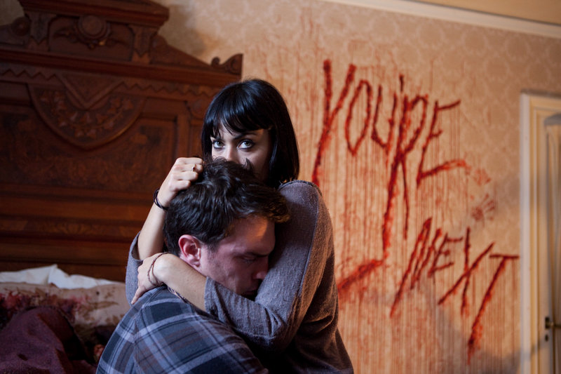"""Nicholas Tucci and Wendy Glenn in a scene from """"You're Next."""""""