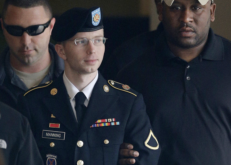 Army Pfc. Bradley Manning is escorted to a vehicle outside a courthouse in Fort Meade, Md., after a hearing in his court martial. Manning said Thursday that he wants to live as a woman named Chelsea.