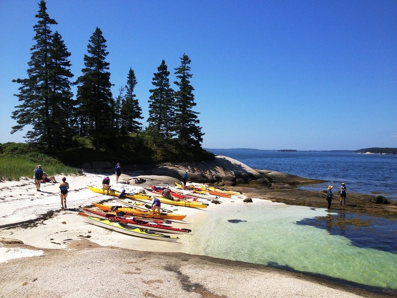 Paddlers enjoy an island visit on the Maine Island Trail off Stonington. The 375-mile recreation water trail, which connects islands and mainland sites from Kittery to the Canadian border, is celebrating its 25th anniversary.