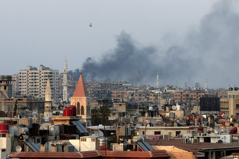Columns of smoke rise from heavy shelling in the Jobar neighborhood in west Damascus, Syria, on Thursday. President Bashar Assad's forces pressed on with a military offensive in eastern Damascus on Thursday, bombing rebel-held suburbs.