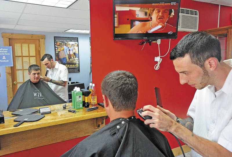 Derrik Vigue trims the neck of Josh Gilbert of Oakland during a cut at the Faded Lines Barber Shop in Oakland on Thursday. Vigue is a rarity in Maine: a young barber.
