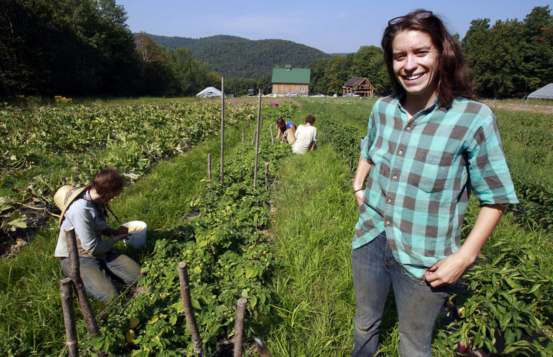 Kara Fitzgerald stands at her new farm location in Shrewsbury, Vt. Two years after Irene washed away 10 acres of summer crops and topsoil, Evening Song Farm is back selling produce, thanks to borrowed money and land.