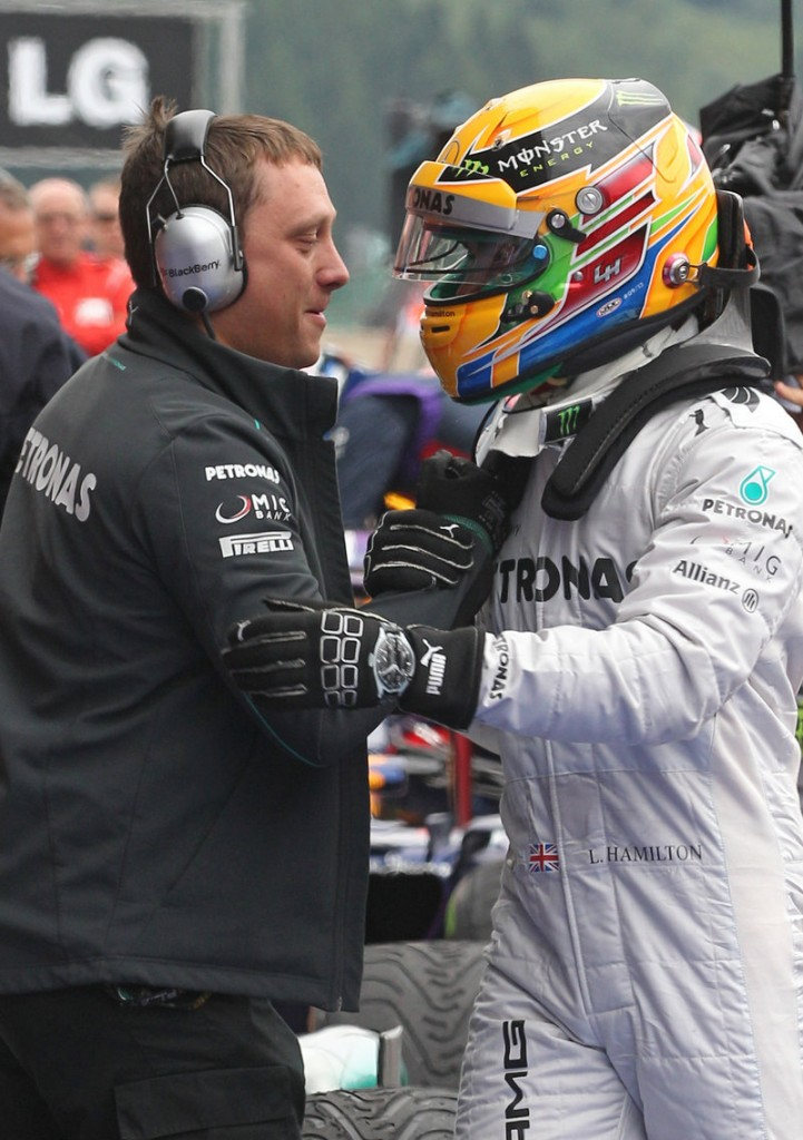 Lewis Hamilton is greeted by his team technician after winning his fourth straight Formula One pole at the Belgian Grand Prix.