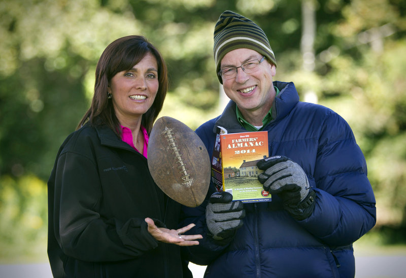 Managing Editor Sandy Duncan, left, and Editor Peter Geiger, pose in Lewiston with a copy of the new Farmers' Almanac.