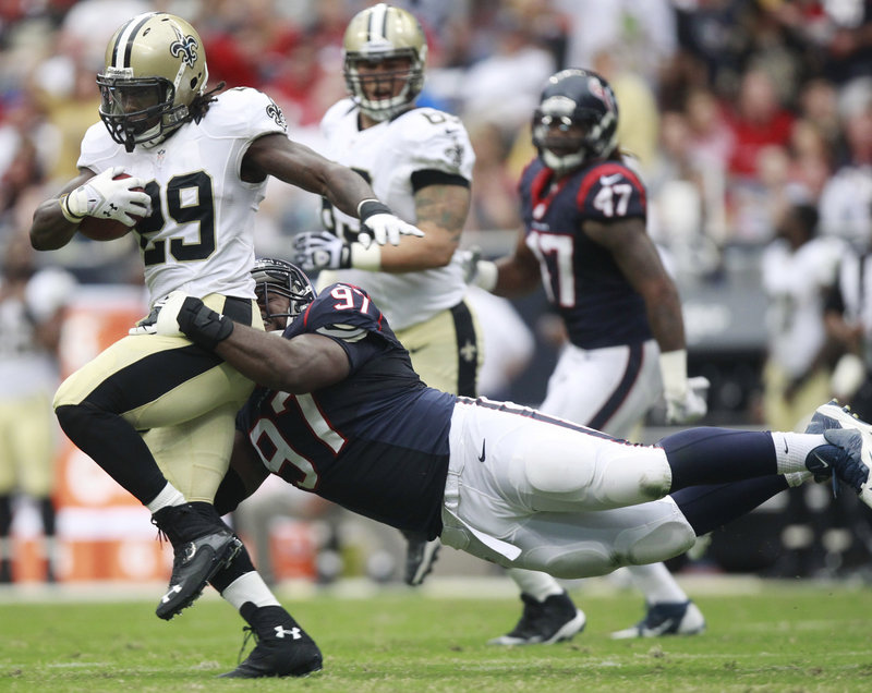 Saints running back Khiry Robinson tries to break away from Houston's Terrell McClain during Sunday's preseason game in Houston. New Orleans won, 31-23.