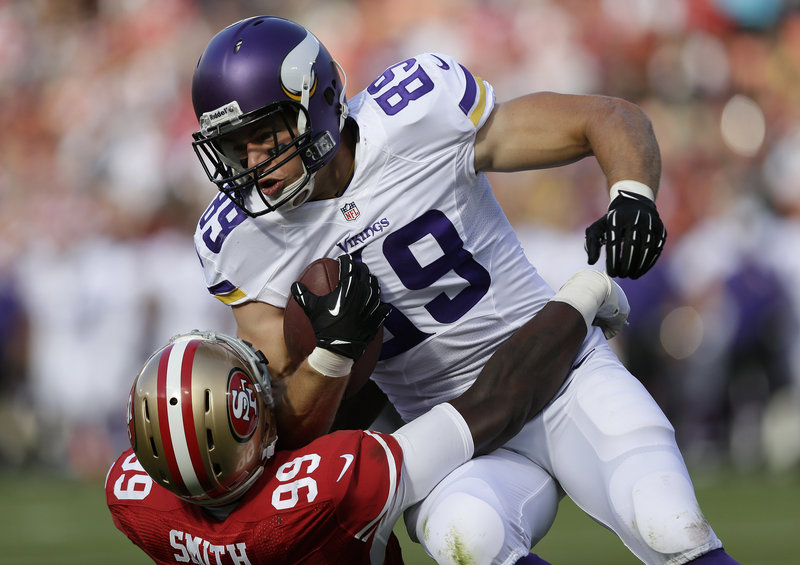 Vikings tight end John Carlson is tackled by Aldon Smith of the 49ers after a short catch during San Francisco's 34-14 win Sunday night.