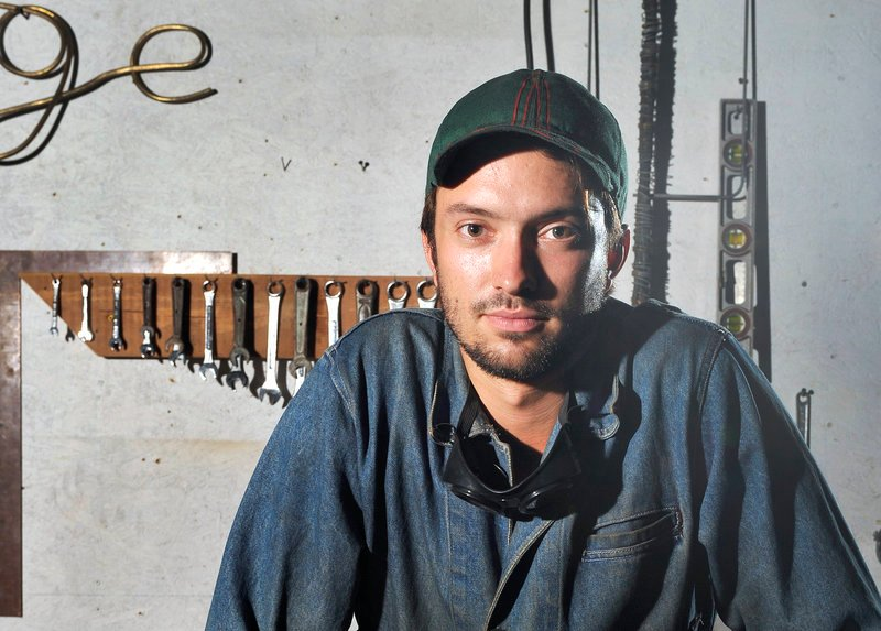 Metal fabricator John Nelson was forced to go off the Portland peninsula to a commercial building on Presumpscot Street in order to find affordable work space, and wishes he could be closer to his West End apartment.