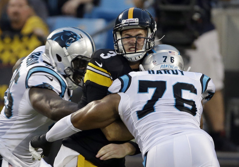 Pittsburgh quarterback Landry Jones gets sandwiched by Carolina's Charles Johnson, left, and Greg Hardy during the Panthers' 25-10 exhibition win at Charlotte, N.C., on Thursday.