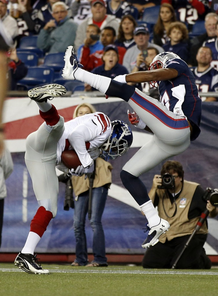 New York cornerback Prince Amukamara, left, intercepts a pass intended for New England wide receiver Aaron Dobson during second-quarter action Thursday.