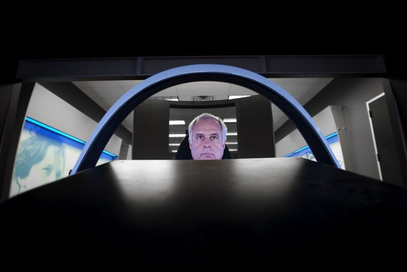Lockheed Martin test pilot Alan Norman sits in the cockpit simulator of the F-35 joint strike fighter earlier this month.
