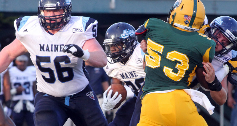 Maine running back Rickey Stevens follows the block of Daniel Carriker to score the game's first touchdown – a 2-yard run in the second quarter.