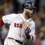 Dustin Pedroia rounds first base after hitting a two-run homer against the Seattle Mariners during the seventh inning at Fenway Park ion Wednesday.