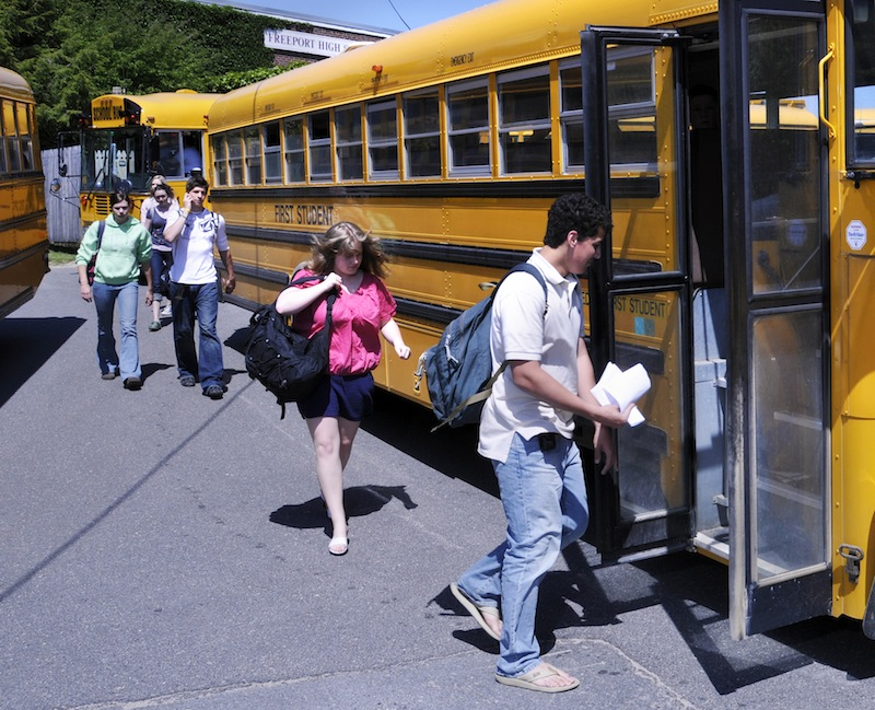 In this May 2008 file photo, Pownal students board the bus at Freeport High School to head back to Pownal. If Freeport schools were to break from the current partnership with Durham and Pownal, the stand-alone district would likely offer fewer academic options and have to close a $4 million budget gap in the first year, according to a study released Friday, Sept. 27, 2013.
