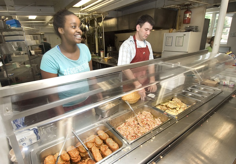 In this 2008 file photo, volunteers prepare and serve breakfast at the Preble Street Resource Center in Portland. The city's largest soup kitchen will close on Friday for renovations and won't reopen until next week. But Preble Street has made arrangements with a Portland church to feed hundreds of homeless persons during the shutdown.