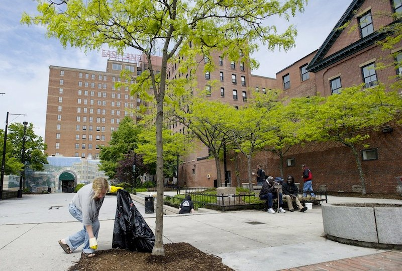 In this May 2012 file photo, Dawn York of South Portland picks up trash in Congress Square Plaza.