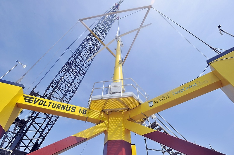 """A scale model of the University of Maine's """"VolturnUS"""" turbine was christened in May. Initial assessments of UMaine's offshore wind proposal will be difficult because UMaine has chosen to keep the entire 100-page document from public view."""