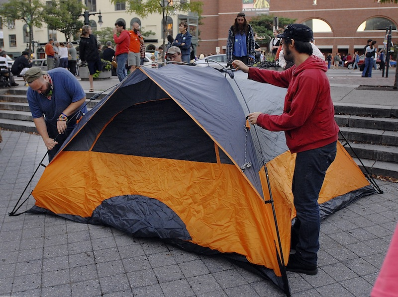 Evan McVeigh and Michael Anthony, members of Occupy Portland, set up their tent to begin an occupation of Congress Square Park in Portland on Friday, Sept. 6, 2013 in effort to raise awareness about the city's pending sale of the public space.