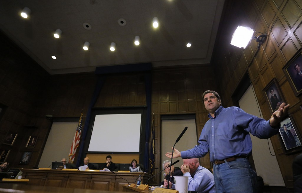 Portland City Councilor John Anton raises his hands in exasperation while discussing the proposed sale of Congress Square Plaza to an Ohio investment firm during the city council meeting Monday, Sept. 16, 2013.