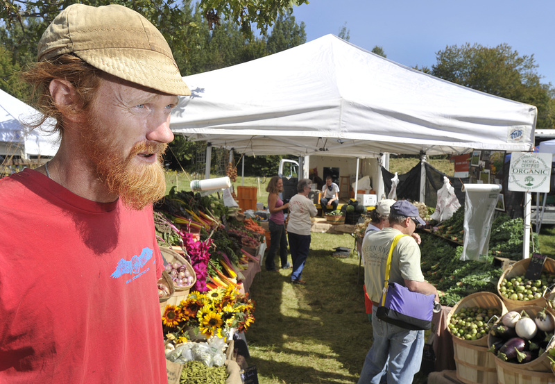 Ian Jerolmack of Stonecipher Farm in Bowdoinham talks about the benefits of organic farming during the opening day of the Common Ground Fair in Unity on Friday.