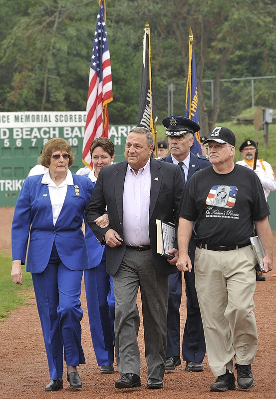 Gov. Paul LePage is escorted onto the field at The Ballpark in Old Orchard Beach to participate in the POW/MIA Recognition Weekend event Saturday.